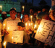 BHOPAL, INDIA - NOVEMBER 15: Muslim kids hold placards with slogans against the ISIS during a candle light vigil to express solidarity with the victims of Paris terror attacks on November 15, 2015 in Bhopal, India. At least 129 people lost their lives in terror attacks by terrorists in Paris at the packed Bataclan concert hall, restaurants and bars, and outside the Stade de France national stadium. The Islamist jihadist group IS, that has seized control of large parts of Syria and Iraq, claimed responsibility for the attacks. (Photo by Mujeeb Faruqui/Hindustan Times via Getty Images)